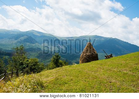 Haystack And Wooden Cart In The Ukrainian Carpathians