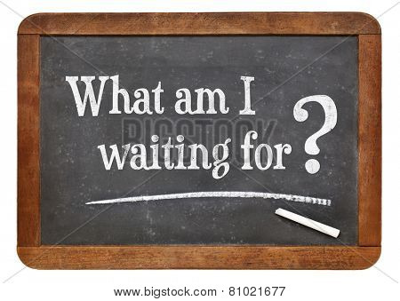 What am I waiting for? A question on a vintage slate blackboard.