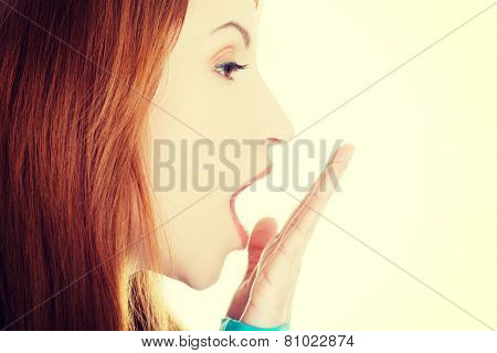 Beautiful caucasian woman's profile yawning.