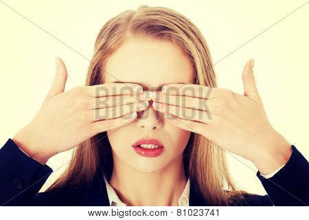 Beautiful business woman covering her eyes.