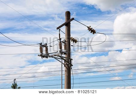 High Voltage Electricity Pylon Over Cloudy Sky