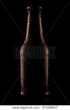 cold bottle of beer on black background