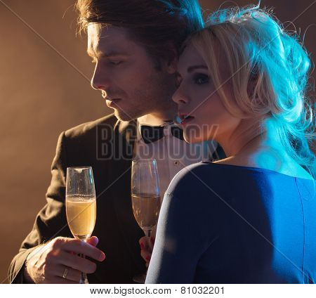 Attractive couple with glasses of champagne