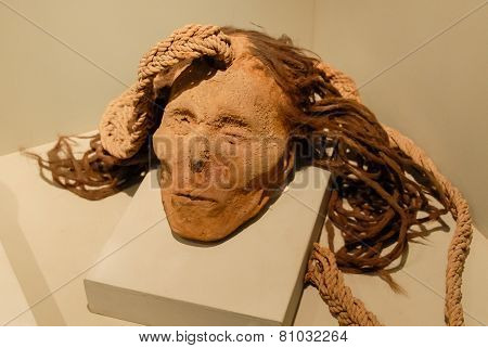Severed Head With Vegetal Rope