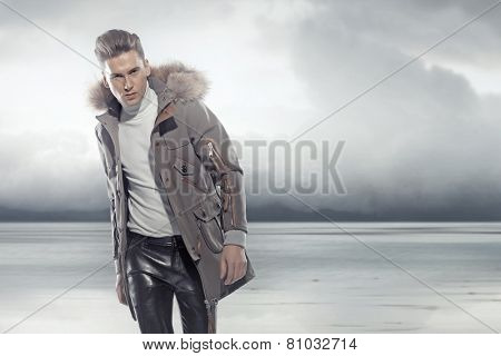 Fashionable man wearing winter jacket