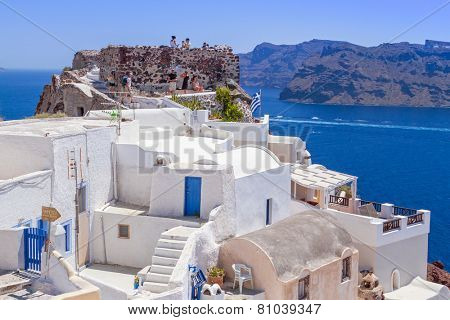 OIA, SANTORINI, GREECE - JUN 21, 2012: Beautiful architecture of Oia town on Santorini island in Greece. Santorini is one of the most popular tourist destinations in Greece.