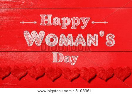 Happy Woman's Day Message On Red Wood Background