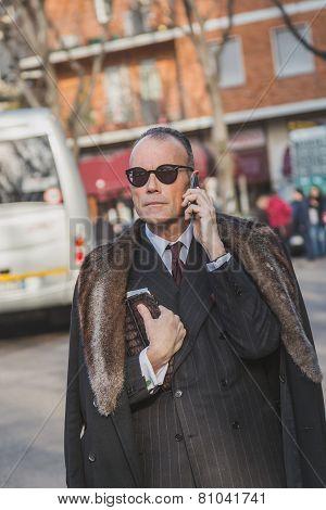 Businessman Outside Armani Fashion Show Building For Milan Men's Fashion Week 2015
