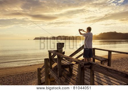 Taking photos of a beautiful sunset with a smartphone
