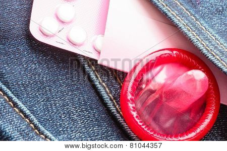 Pills And Condom In Denim Pocket.
