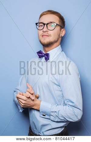 Portrait of handsome young man wearing in a shirt and bow tie