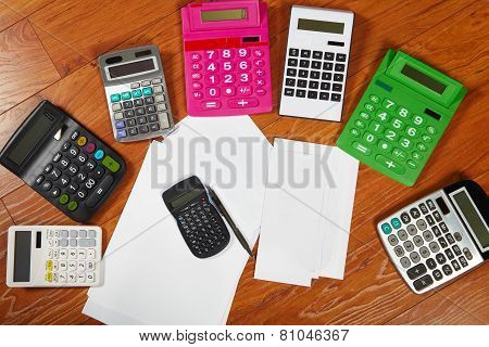 Calculators Lying On The Wooden Flooring
