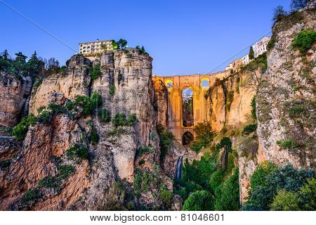 Ronda, Spain at Puente Nuevo Bridge at dusk.