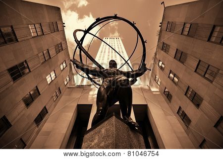 NEW YORK CITY, NY - MAR 30: Rockefeller Plaza Atlas statue on March 30, 2014 in New York City. Declared a National Historic Landmark in 1987, it is a complex of 19 commercial buildings