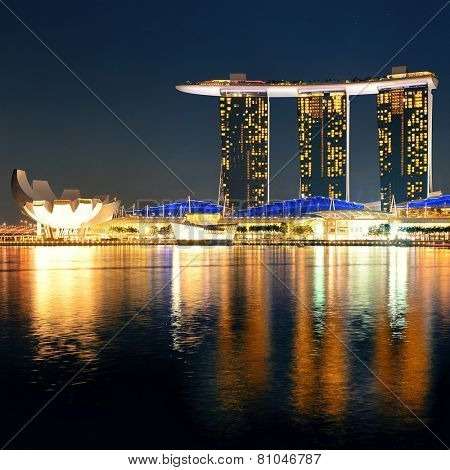 SINGAPORE - APR 5: Marina Bay Sands hotel closeup at night on April 5, 2014 in Singapore. It is the world's most expensive building with cost of US$ 4.7 billion and landmark of Singapore.