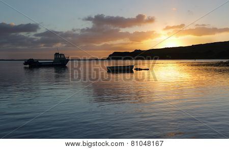 Boats On The Water At Sunrise