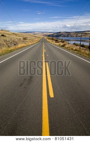 Straight Country Highway With Yellow Markings