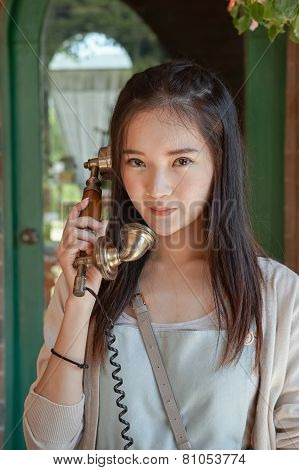 Woman  Talking On Vintage Telephone