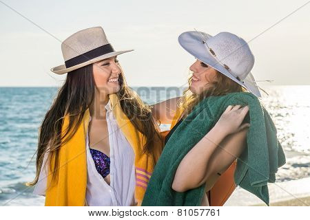 Pretty Girls At The Beach Looking Each Other
