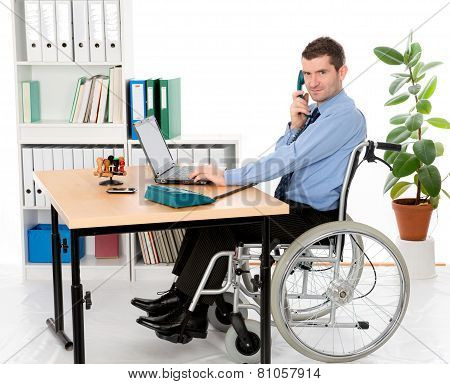 Man In Wheelchair Is Working