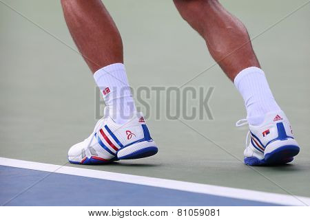 Six times Grand Slam champion Novak Djokovic wears custom Adidas tennis shoes during US Open match