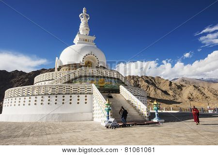 An unidentified Lama Tibetan walk around the Shanti Stupa