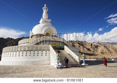 An unidentified Lama Tibetan walk around the Shanti Stupa