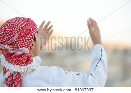 Muslim Arabic boy praying