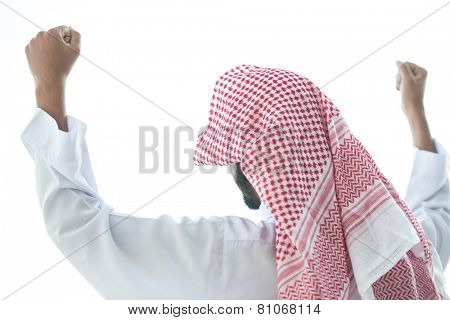 Successful Arabic man celebrating win