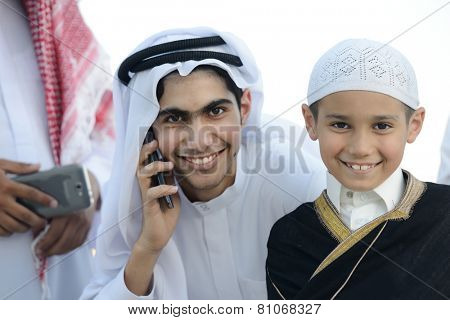 Arabic Gulf people talking on cell phone