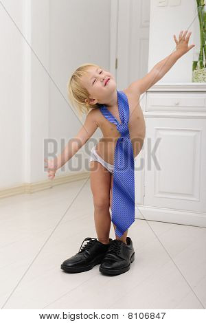 Corporate Succession: Child With Tie And Shoes Posing