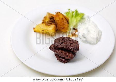 plate with beef and potatoes and gravy