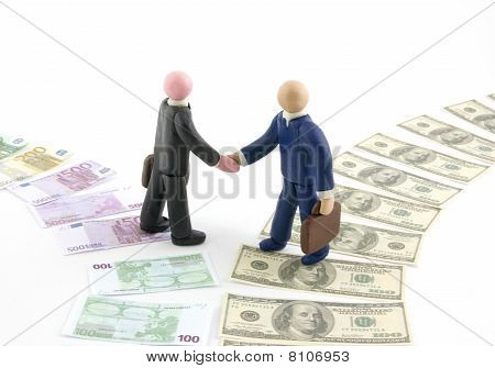 Businessmen Figures Shaking Hands.
