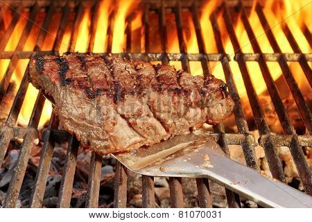 Roasted Beefsteak On The Spatula Over A Hot Bbq Grill