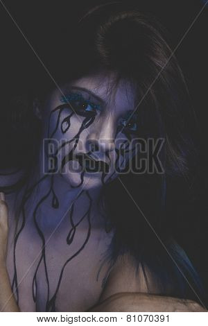 frustration, representation of sadness, beautiful woman with painted tears on the face