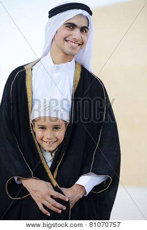 Happy Arabic boy wearing shaikh clothes