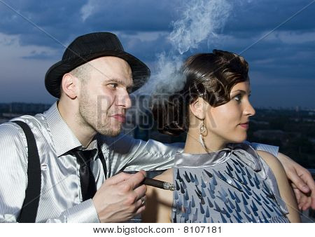 Smoking Impudent Gangster With Retro Girl