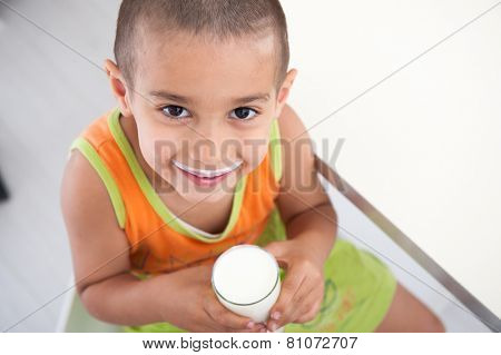 Happy kid with healthy food in kitchen