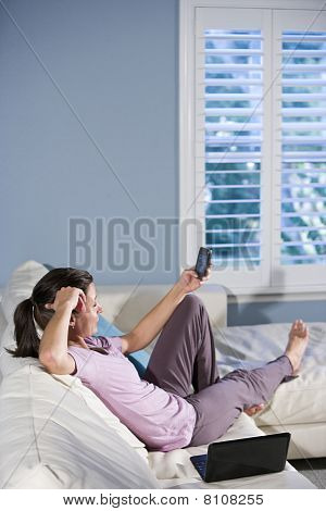 Woman Relaxing And Looking At Text Messages