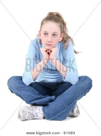 Beautiful Teen Girl Sitting Thinking Over White