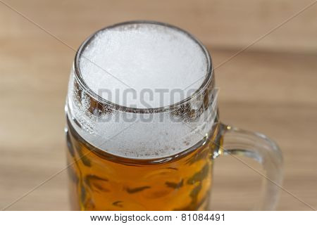 Beer With A Frothy Head In A Glass Beer Mug