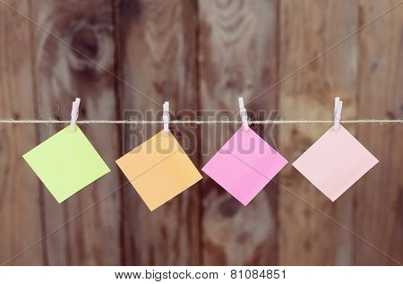 Colored Pieces Of Paper Hanging On A Rope