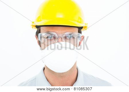 Close-up portrait of worker wearing protective mask and glasses over white background