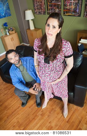 Husband With Exhausted Pregnant Woman