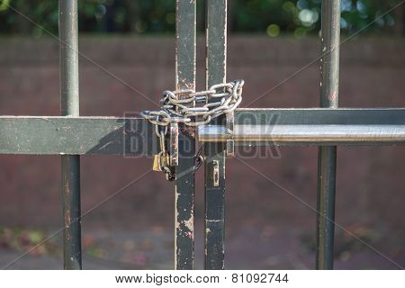 Locked Padlock With Chain Bound To The Door