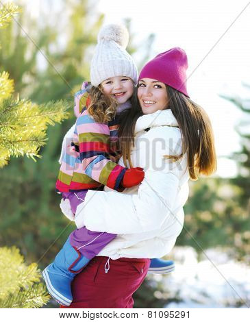 Winter And People Concept - Mother And Child Having Fun Playing Outdoors In The Winter Day