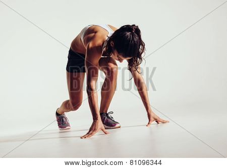 Fit Female Athlete Ready To Run