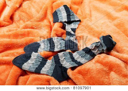 Female Socks On An Orange Blanket