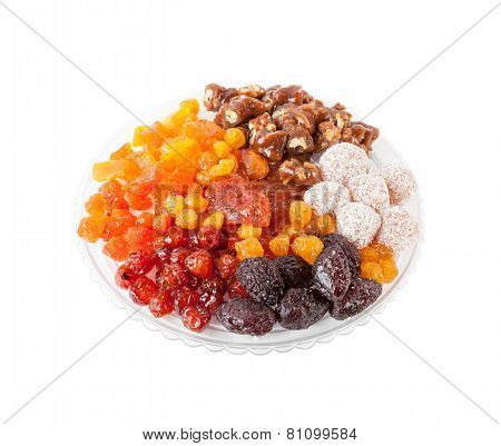 Dried fruits on glass plate isolated over white background.