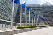 stock photo of european  - European flags in front of headquarters of European commission in Brussels in summer day - JPG